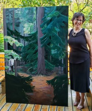 Celese with her painting Into the Woods. Photo by AILEEN CROWNE.