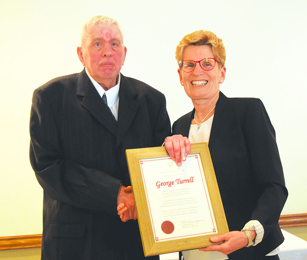 George Turrell received award from Kathleen Wynne. Photo by Dan Girard.