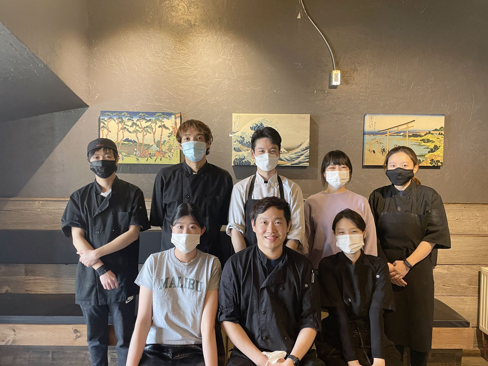 Chef Beomsoo Kim front, centre and the Sushi by K team. Photo by Sein Yang.