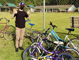 Alec Locklin with bikes he collected for the Gateway Bike Hub. Photo by Holly Reid.