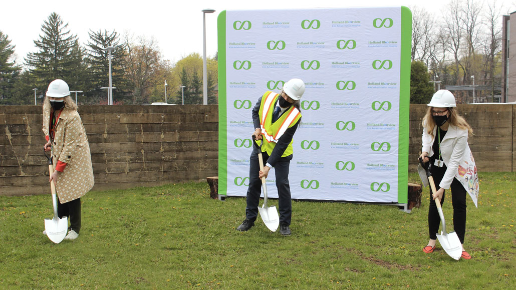 L-r: Julia Hanigsberg, President CEO, Tom Chau, Vice-President of Research, and Sandra Hawken, President and CEO of Holland Bloorview Foundation break ground on the hospital expansion. Photo from Holland Bloorview.