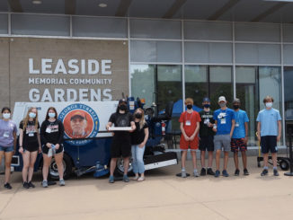 """In June, the LMCG, together with volunteers from its user groups (Leaside Hockey Association, Leaside Skating Club, Toronto Leaside Girls Hockey Association, Hockey Extreme) and the community, hosted a food drive in honour of the """"King of Leaside"""" – George Turrell. As a result, 47 boxes of food were delivered to Thorncliffe Park's TNO Food Bank. Conspiracy Pizza provided lunch for the volunteers. Photo from LMCG."""
