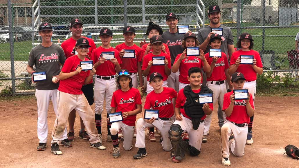 Photo of The Leaside 12U A baseball team, led by coaches Aaron Niman, Trevor Currie, Blair Ridsdale and Kenneth Pittman had an outstanding season. After going an impressive 27-2-1 in the regular season, the boys brought home both the City and Provincial Championships. Photo taken by David Hershenhorn.