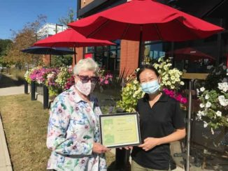In August 2021 Nora Campbell, President presented the winner a certificate for the Community Award to Connie Lau, Manager of Aroma Espresso Bar in the Longo's Plaza.